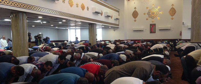 People kneeling in the mosque